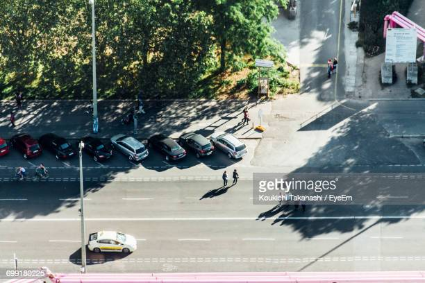 High Angle View Of People And Cars On Road
