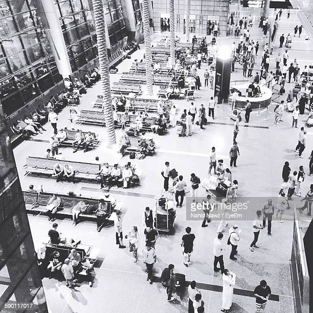 High Angle View Of People At Airport Lobby