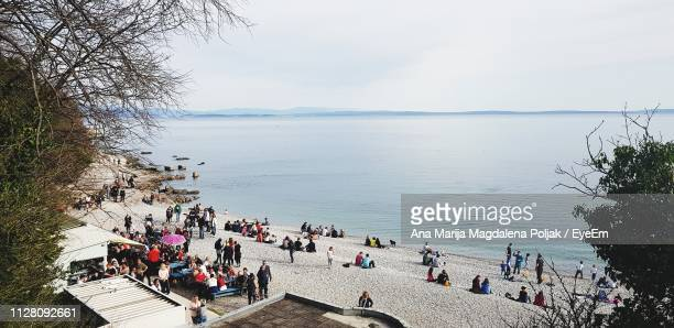 high angle view of people at beach against sky - rijeka stock pictures, royalty-free photos & images