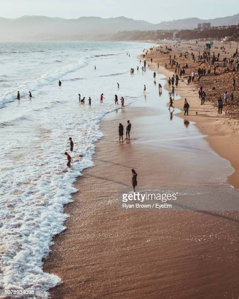 high angle view of people at beach during sunset - santa monica stock pictures, royalty-free photos & images