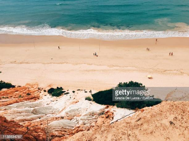 high angle view of people at beach - albufeira stock pictures, royalty-free photos & images