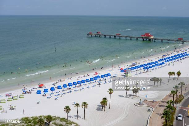 high angle view of people at beach - clearwater beach stock pictures, royalty-free photos & images