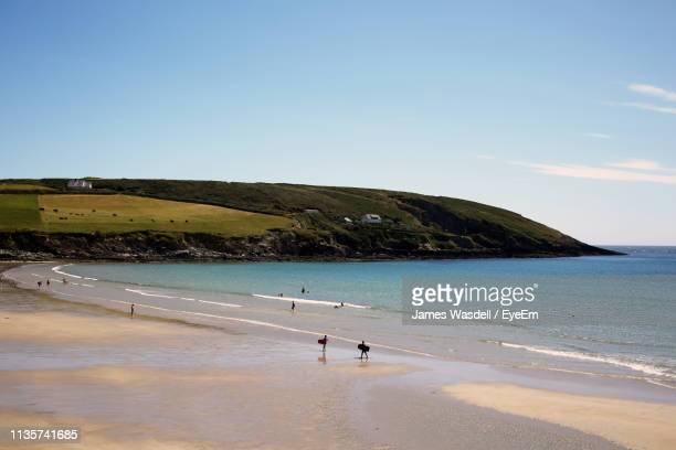 high angle view of people at beach - county cork stock pictures, royalty-free photos & images