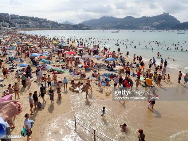 high angle view of people at beach - crowded beach stock pictures, royalty-free photos & images