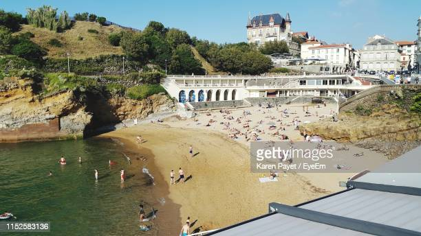 high angle view of people at beach - biarritz stock pictures, royalty-free photos & images