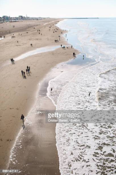 high angle view of people at beach - bortes stockfoto's en -beelden