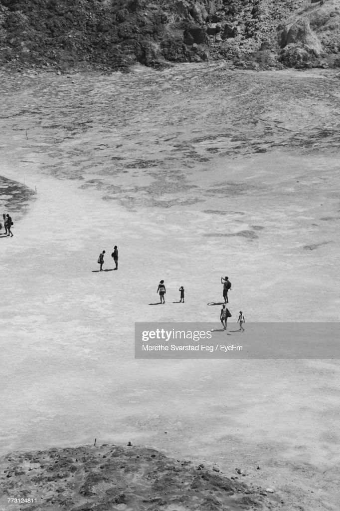 High Angle View Of People At Beach : Photo