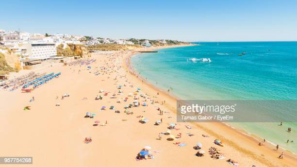 high angle view of people at beach - nigeria stock pictures, royalty-free photos & images