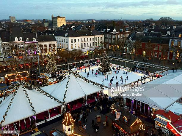 High Angle View Of People At Christmas Market In City
