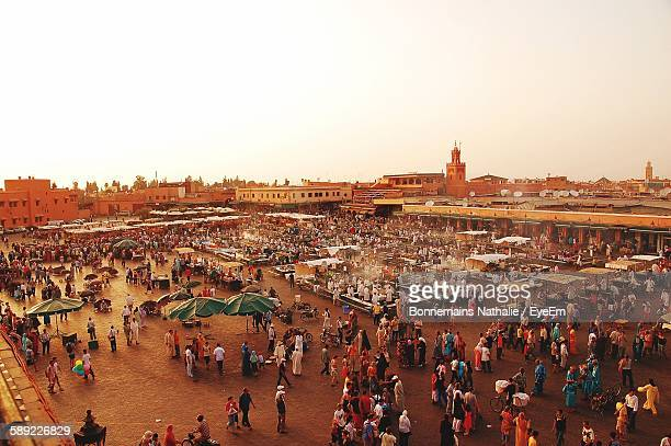 high angle view of people at djemma el fna square - marrakesh stock pictures, royalty-free photos & images