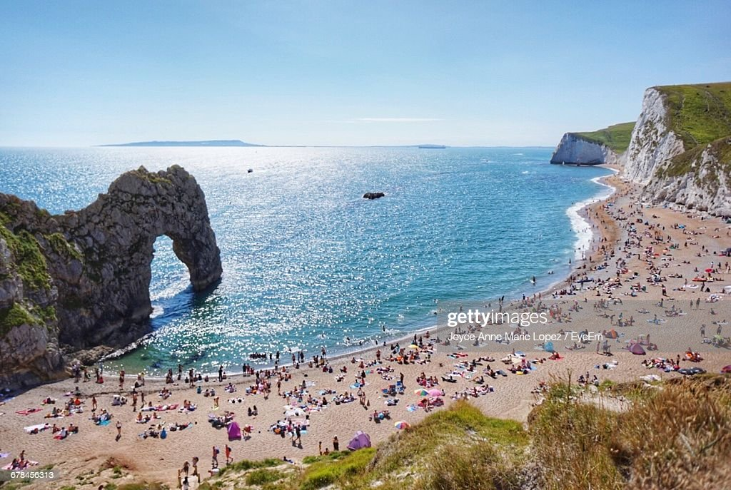 High Angle View Of People At Durdle Door Beach Against Clear Blue Sky & Durdle Door Stock Photos and Pictures | Getty Images