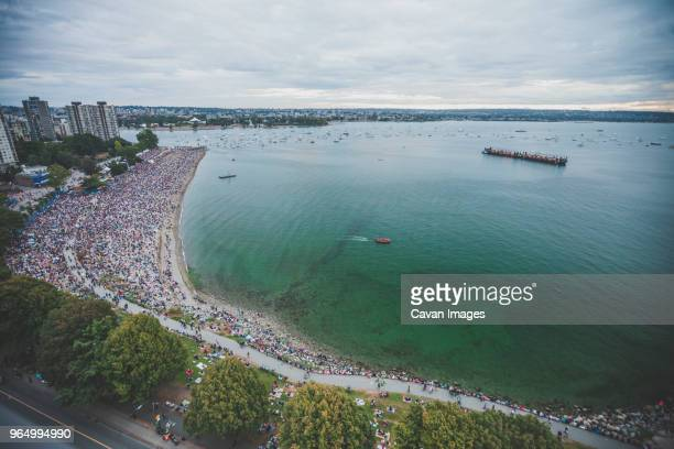 high angle view of people at english bay - english bay stock photos and pictures