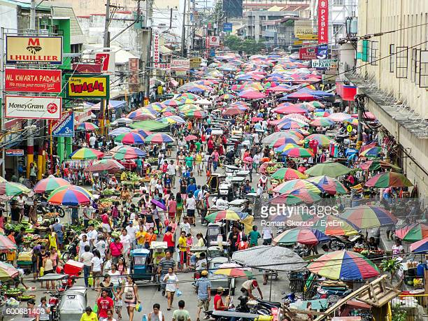high angle view of people at market in city - manila philippines stock pictures, royalty-free photos & images