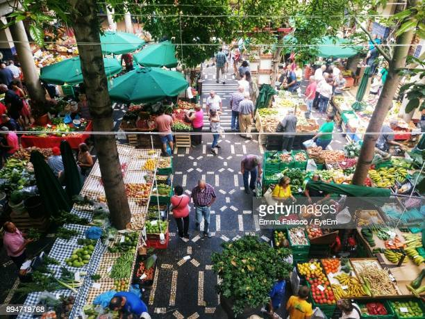 high angle view of people at market - markt stockfoto's en -beelden