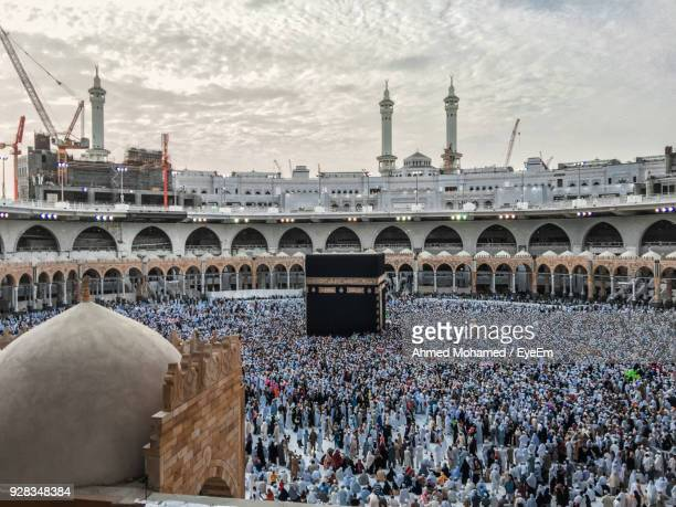 high angle view of people at mosque - mecca stock photos and pictures