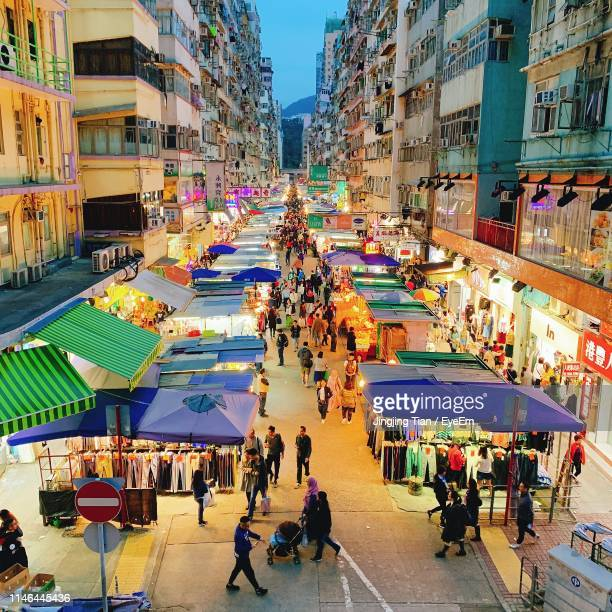 high angle view of people at night street market in city - kowloon peninsula stock pictures, royalty-free photos & images