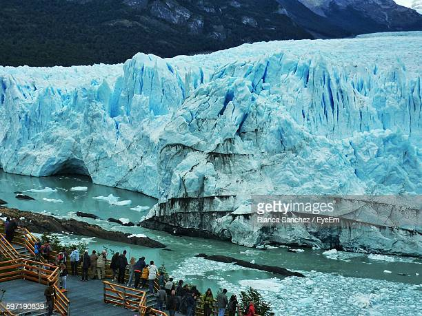 High Angle View Of People At Observation Point Against Perito Moreno Glacier