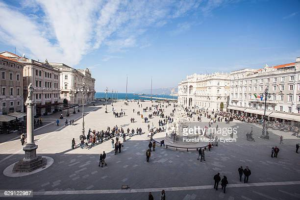 high angle view of people at piazza unita d italia against sky - トリエステ ストックフォトと画像