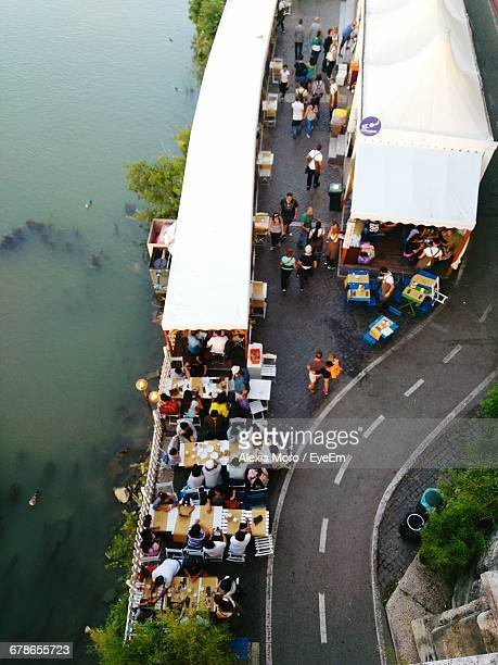 High Angle View Of People At Sidewalk Cafe By Tiber River
