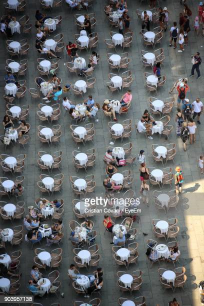 High Angle View Of People At Sidewalk Cafe