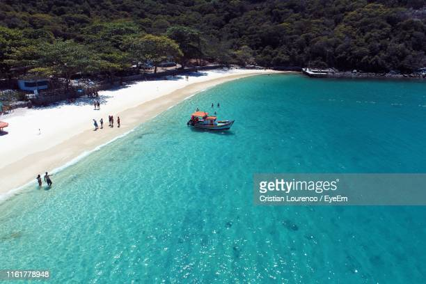 high angle view of people by boat in sea - arraial do cabo imagens e fotografias de stock