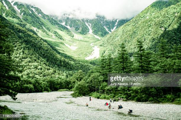 high angle view of people by river and mountains - 長野市 ストックフォトと画像