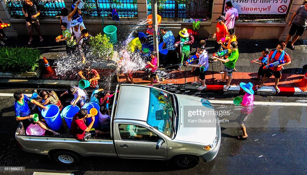 High Angle View Of People Celebrating Water Festival : Stock Photo