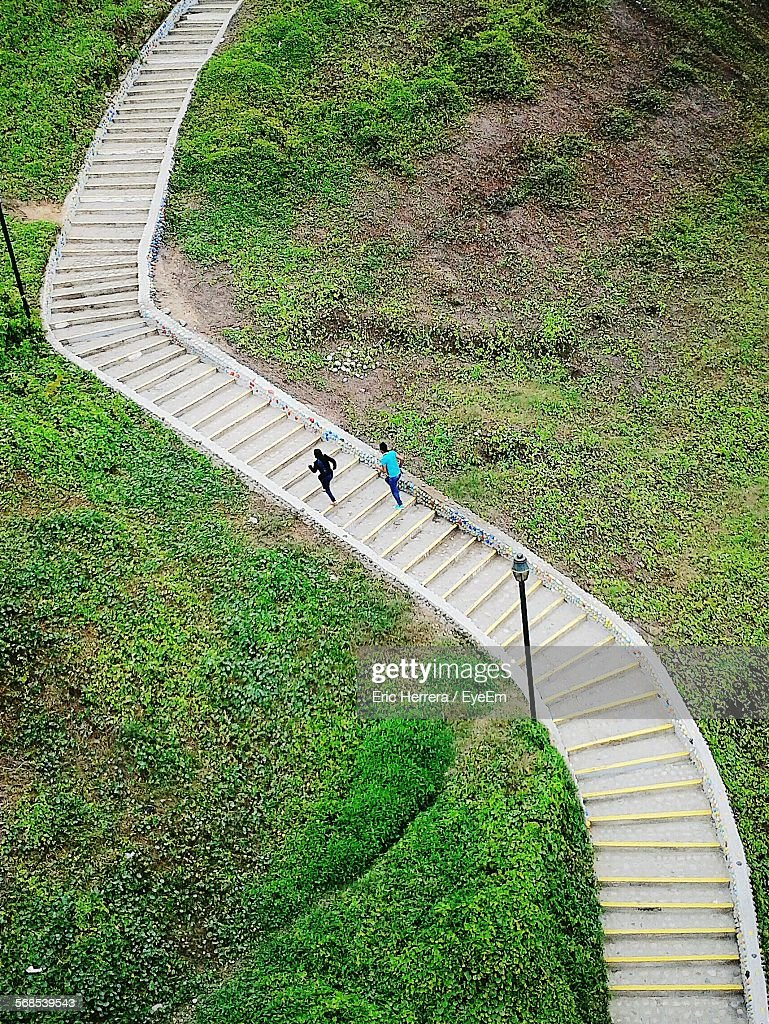 High Angle View Of People Climbing Stairs : Stock Photo