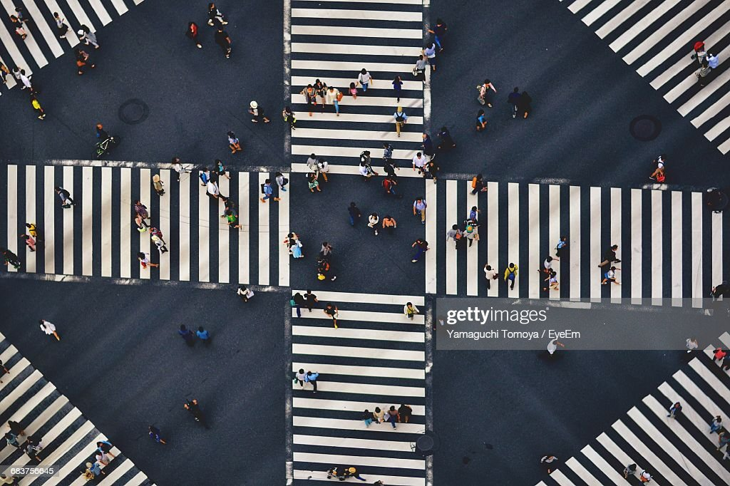 High Angle View Of People Crossing The Street : Stock Photo