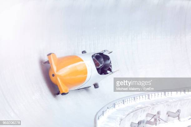 high angle view of people during bobsledding - bobsleigh stock pictures, royalty-free photos & images