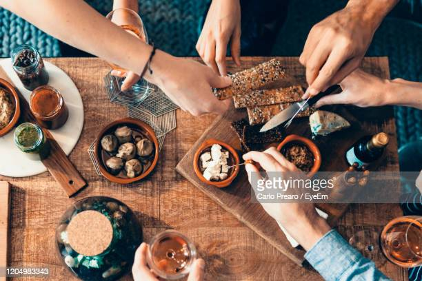 high angle view of people eating food - cracker snack stock pictures, royalty-free photos & images