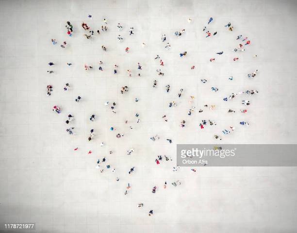 high angle view of people forming a heart - large group of people stock pictures, royalty-free photos & images