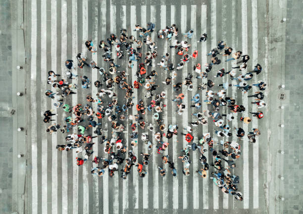 high angle view of people forming a speech bubble - people stock pictures, royalty-free photos & images