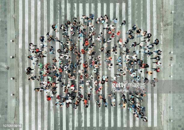 high angle view of people forming a speech bubble - large group of people stock pictures, royalty-free photos & images