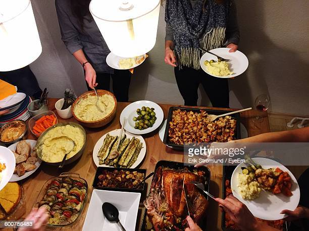 high angle view of people having dinner at home - banquet stock pictures, royalty-free photos & images