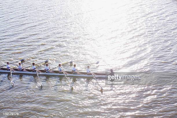 High angle view of people in canoe oaring