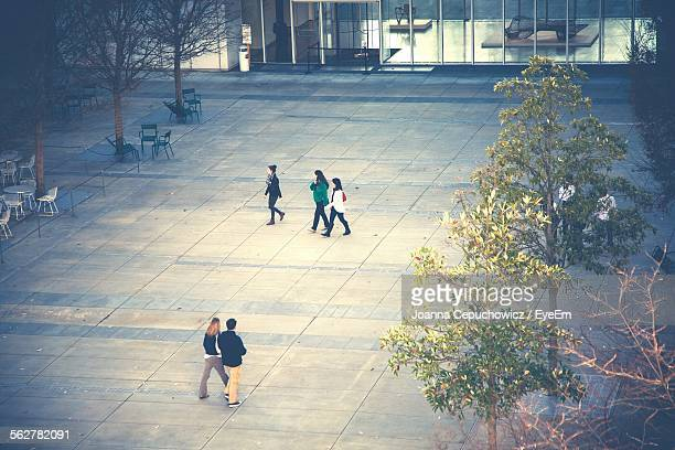 High Angle View Of People In Courtyard Of Building