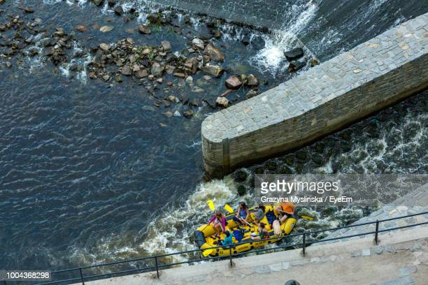 High Angle View Of People In Raft On Sea