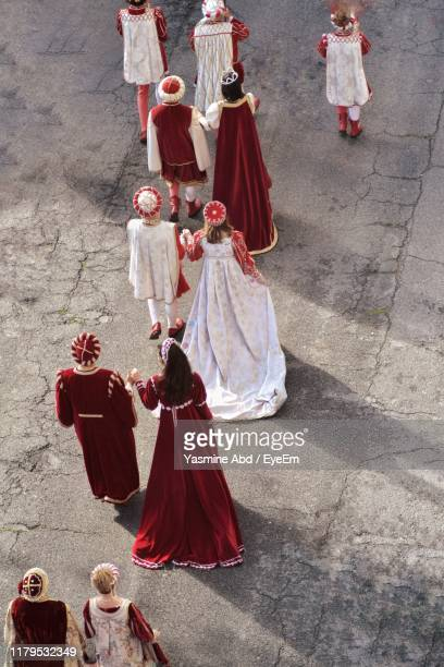 high angle view of people in traditional clothing standing on road - medieval stock pictures, royalty-free photos & images