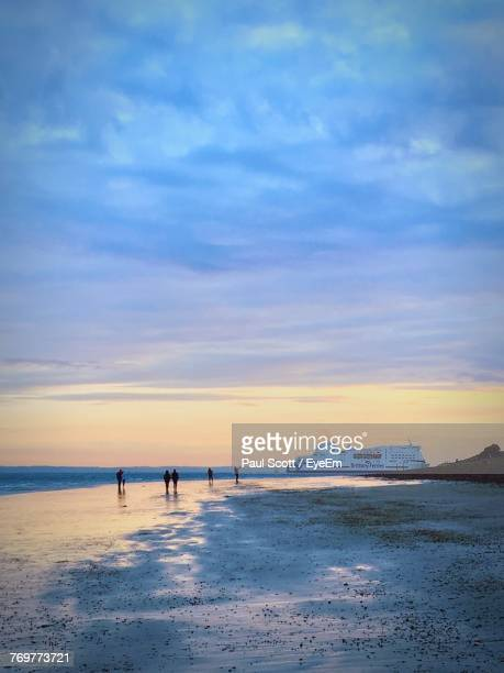high angle view of people on beach against sky during sunset - portsmouth england stock pictures, royalty-free photos & images