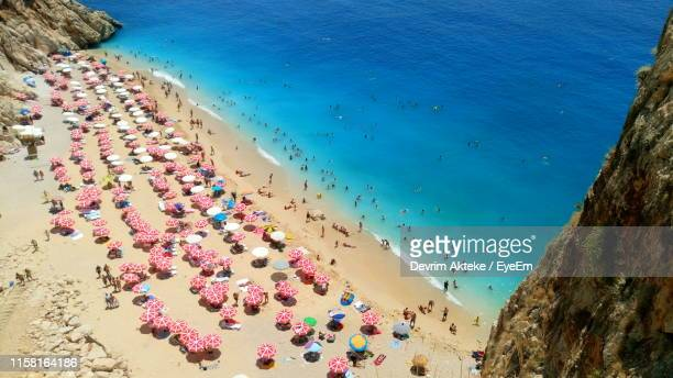 high angle view of people on beach - kas stock pictures, royalty-free photos & images