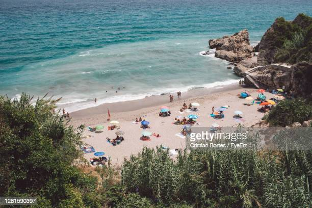 high angle view of people on beach - bortes stock pictures, royalty-free photos & images
