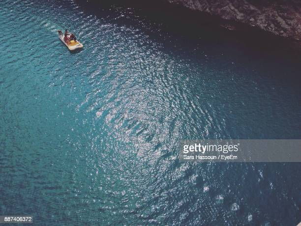 High Angle View Of People On Boat In Lake