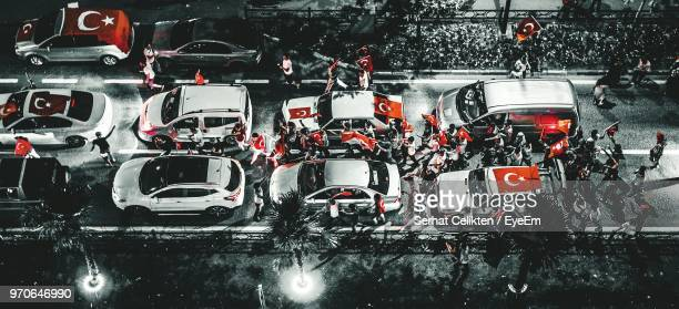 high angle view of people on by cars on road - isolated color stock pictures, royalty-free photos & images