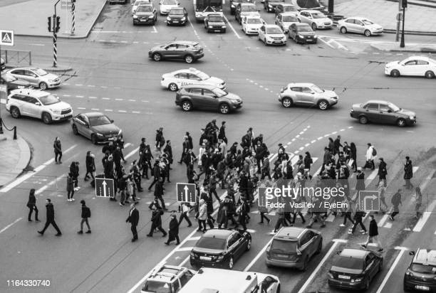 high angle view of people on city street - fedor stock pictures, royalty-free photos & images