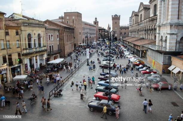high angle view of people on city street - ferrara stock pictures, royalty-free photos & images