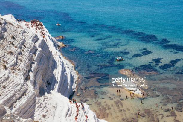 high angle view of people on cliff by sea - agrigento stock pictures, royalty-free photos & images