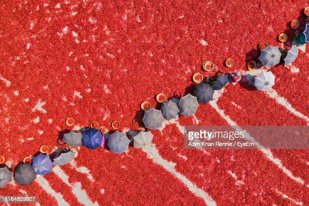 high angle view of people on field - bangladesh stock pictures, royalty-free photos & images