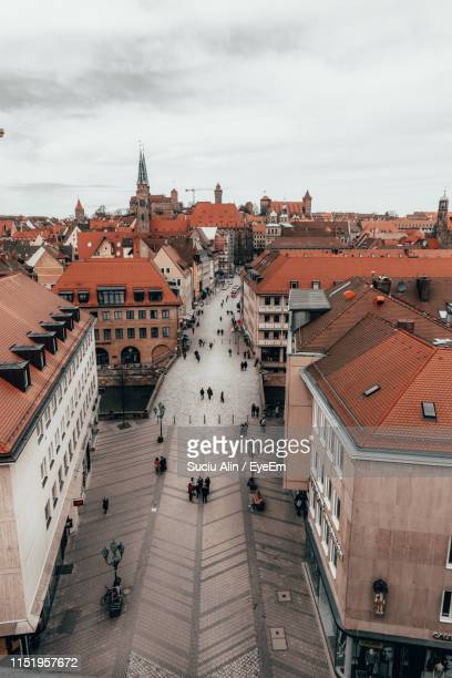high angle view of people on footpath amidst buildings in town - nuremberg stock pictures, royalty-free photos & images