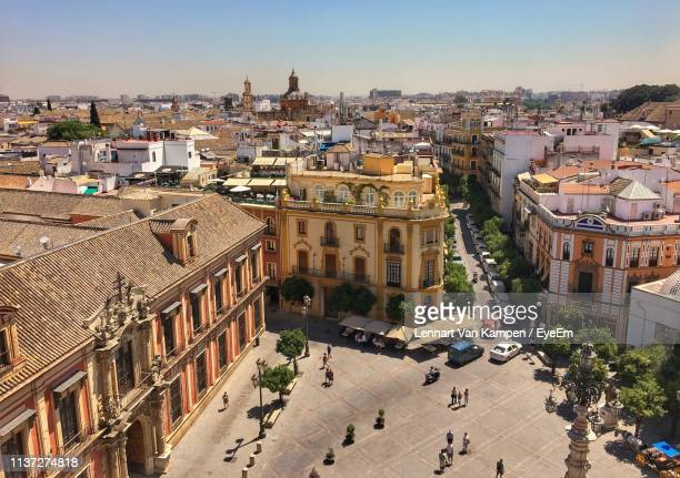 high angle view of people on footpath in city - seville stock pictures, royalty-free photos & images